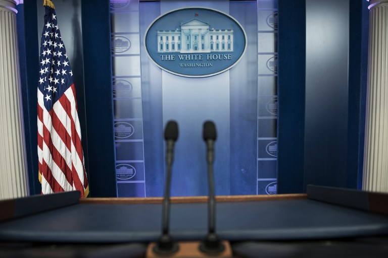 An empty podium is seen as an off camera briefing is held with a small group of reporters and White House Press Secretary Sean Spicer instead of the normal on camera briefing in the White House February 24, 2017 in Washington, DC. (AFP PHOTO / Brendan Smialowski)