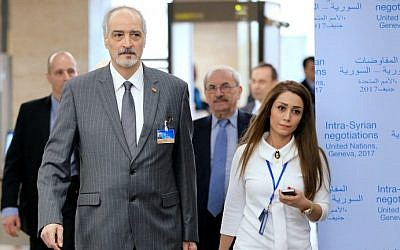 Syrian Ambassador to the UN, Bashar Jaafari (C) arrives for a meeting of Intra-Syria peace talks with UN Special Envoy for Syria at the Palais des Nations in Geneva on February 25, 2017. (AFP Photo/Pool/Pierre Albouy)
