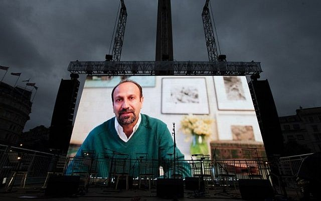 Iranian filmmaker Asghar Farhadi speaks in a recorded video message during the public screening for the film 'The Salesman' in Trafalgar Square in central London on February 26, 2017. (AFP PHOTO / Daniel LEAL-OLIVAS)