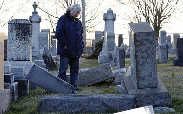 A man looks at fallen tombstones at the Jewish Mount Carmel Cemetery, February 26, 2017, in Philadelphia. AFP/DOMINICK REUTER)
