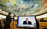 Palestinian Authority President Mahmud Abbas is seen on a TV screen while speaking during a meeting of the United Nations Human Rights Council on February 27, 2017 in Geneva, Switzerland (AFP/Fabrice Coffrini)