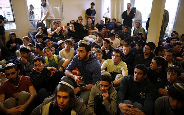 Young right-wing activists sit inside a house which is due to be evicted and demolished in the West Bank settlement of Ofra, on February 28, 2017. (Menahem Kahana/AFP Photo)
