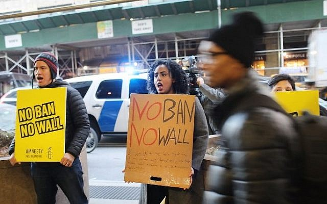 Activists participate in a protest against President Donald Trump's immigration policies in front of the Department of Homeland Security New York headquarters on February 6, 2017 in New York City. (Spencer Platt/Getty Images/AFP)