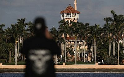 An onlooker takes a photo of the Mar-a-Lago Resort as President Donald Trump is hosts Japanese Prime Minister Shinzo Abe on February 11, 2017 in West Palm Beach, Florida. (Joe Raedle/Getty Images/AFP)
