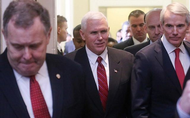 US Vice President Mike Pence, center, departs a Republican policy lunch with Sen. Rob Portman (R-OH), right, on Capitol Hill, Washington DC, February 14, 2017. (Mario Tama/Getty Images/AFP)