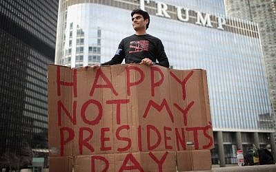 Arturo Gomez participates in a Presidents Day protest near Trump Tower on February 20, 2017 in Chicago, Illinois. The demonstration was one of many anti-Trump rallies held around the country on the federal holiday billed as Not My Presidents Day. (Scott Olson/Getty Images/AFP)