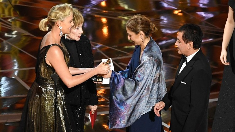 HOLLYWOOD, CA - FEBRUARY 26: Engineer/astronaut Anousheh Ansari (C) and former NASA scientist Firouz Naderi (R) accept Best Foreign Language Film for 'The Salesman' on behalf of director Asghar Farhadi onstage with actors Charlize Theron and Shirley MacLaine during the 89th Annual Academy Awards at Hollywood Highland Center on February 26, 2017 in Hollywood, California. (Kevin Winter/Getty Images/AFP)