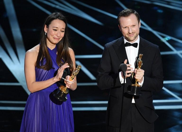 Producer Joanna Natasegara (L) and director Orlando von Einsiedel accept Best Documentary Short Subject