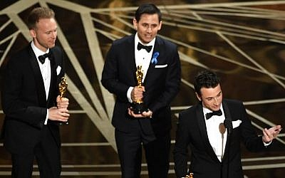 (L-R) Songwriters Justin Paul, Benj Pasek and Justin Hurwitz accept Best Original Song for 'City of Stars' from 'La La Land' onstage during the 89th Annual Academy Awards at Hollywood and Highland Center on February 26, 2017 in Hollywood, California. (Kevin Winter/Getty Images/AFP)