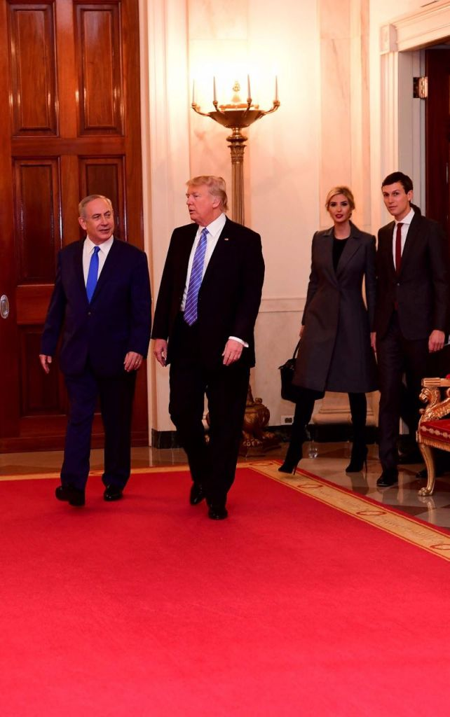 Prime Minister Benjamin Netanyahu and President Donald Trump walk in the White House on February 15, 2017, followed by Jared Kushner and Ivanka Trump (Shmulik Armani)