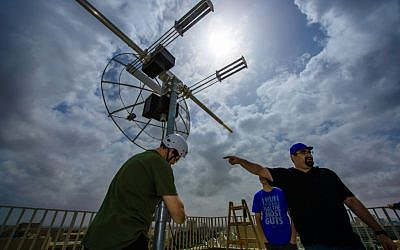 Installing the satellite dish that will receive the data transmitted from BGUSAT and send it to the ground station at Ben-Gurion University's  Earth and Planetary Image Facility, March 2016. (Dani Machlis/BGU)