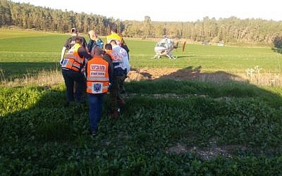 First responders evacuating the wounded at the scene of a car crash in southern Israel in which 18 Palestinians were injured on February 7, 2017. (United Hatzalah spokesperson)
