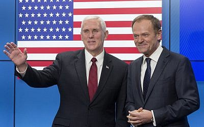 United States Vice President Mike Pence, left, gestures after shaking hands with EU Council President Donald Tusk as he arrives at the European Council building in Brussels, Belgium, on Monday, Feb. 20, 2017. (AP Photo/Thierry Monasse)