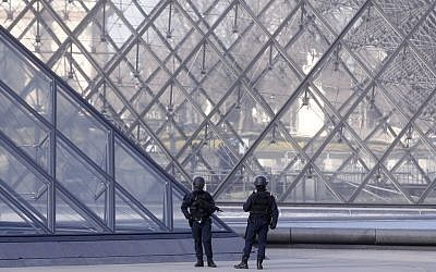 Police officers patrol at the pyramid outside the Louvre museum in Paris,Friday, Feb. 3, 2017.  (AP Photo/Thibault Camus)