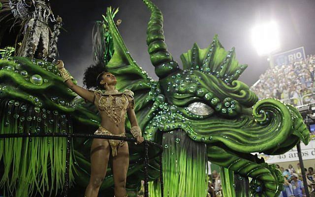 A performer from Mocidade samba school parades on a float during the Carnival celebrations at the Sambadrome in Rio de Janeiro, Brazil, February 8, 2016. (AP/Leo Correa)