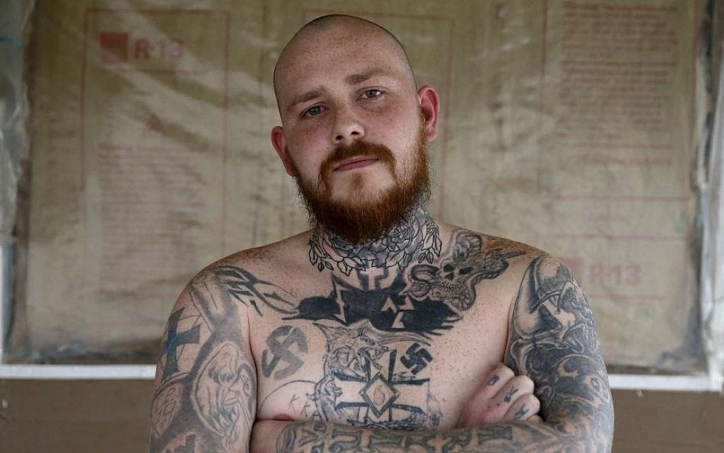 Shane Johnson displays some of his tattoos as he poses in his home in Tippecanoe, Indiana, Thursday, Jan. 12, 2017. (AP Photo/Michael Conroy)