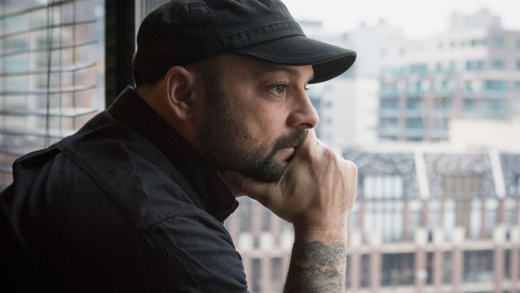 Christian Picciolini, founder of the group Life After Hate, poses for a photograph in his Chicago home, Jan. 9, 2017. (AP Photo/Teresa Crawford)