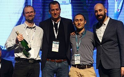Left to right: Aperio's Yevgeni Nogin, YL Ventures' Yoav Lightersdorf, Aperio's Michael Shalyt, and Ofer Schreiber, a partner at YL Ventures at CyberTech 2017 (Courtesy: Gilad Kavalerchik)