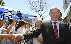 Prime Minister Benjamin Netanyahu, right, shakes the hand of a student during a visit the Moriah War Memorial College in Sydney, February 23, 2017.  (Dean Lewins/Pool via AP)