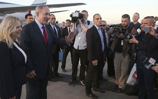 Israeli Prime Minister Benjamin Netanyahu speaks to the media after he and his wife, Sara arrive in Sydney for a four-day visit to Australia, February 22, 2017. (AP Photo/Rick Rycroft)