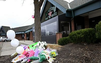 A small memorial for Srinivas Kuchibhotla is displayed outside Austins Bar and Grill in Olathe, Kansas, Friday, February 24, 2017. Kuchibhotla was shot and killed at the bar Wednesday, February 22. (AP/Orlin Wagner)
