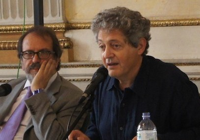 Georges Bensoussan, right, at a talk with Mino Chamla in Milan, Italy, Sept. 16 2014. (Moked/Federico Valente via JTA)