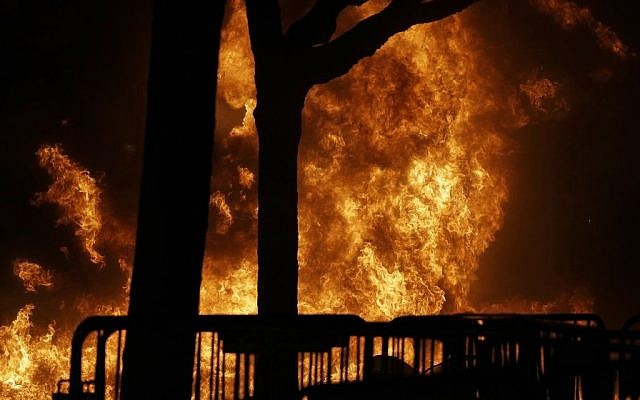A fire set by demonstrators protesting a scheduled speaking appearance by Breitbart News editor Milo Yiannopoulos burns on Sproul Plaza on the University of California at Berkeley campus on Wednesday, Feb. 1, 2017, in Berkeley, Calif.  (AP/Ben Margot)