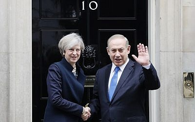 Britain's Prime Minister Theresa May greets Prime Minister Benjamin Netanyahu at Downing Street in London on Feb. 6, 2017. (AP Photo/Kirsty Wigglesworth)