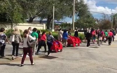 Children and staff heading back to a Jewish school in Davie, Florida, on February 27, 2017 after police gave the all-clear following a hoax bomb threat. (screen capture: Erica Rakow/Twitter)