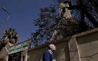 A Christian man who fled el-Arish stands outside the Evangelical Church in Ismailia, 120 kilometers (75 miles) east of Cairo, Egypt, Sunday, Feb. 26, 2017. Egyptian Christians fearing attacks by Islamic State militants are fleeing the volatile northern part of the Sinai Peninsula for a fourth day, after a string of sectarian killings there sent hundreds fleeing and raised accusations the government is failing to protect the minority. (AP Photo/Nariman El-Mofty)