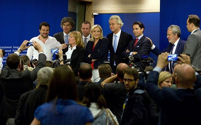 In this June 16, 2015, file photo, French far right leader of the Front National, Marine Le Pen, center, poses with other members of the far right after a media conference at the European Parliament in Brussels. (AP Photo/Virginia Mayo, File)