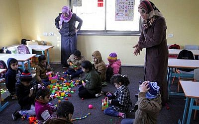 Illustrative photo of deaf Palestinian children playing at a rehabilitation foundation for deaf children, in Khan Younis in the Gaza Strip. January 18, 2015. (Abed Rahim Khatib/Flash90)