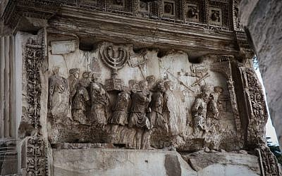 A depiction of Jewish captives and the gold menorah taken from Jerusalem following the destruction of the city in 70 CE, seen on the Arch of Titus, in Rome, Italy, October 20, 2016. (Yossi Zamir/Flash90)