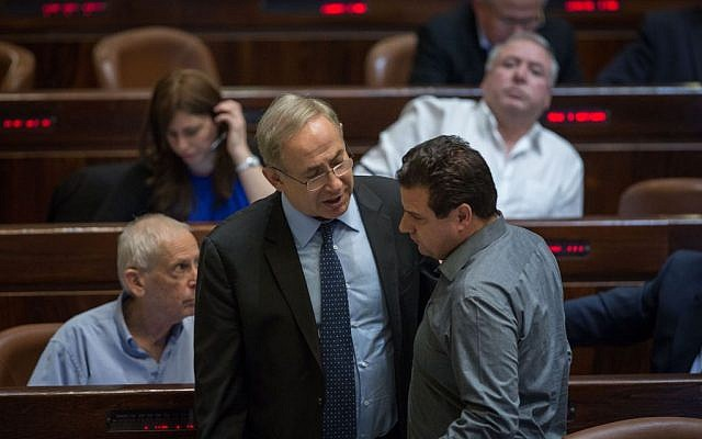 Prime Minister Benjamin Netanyahu and Joint (Arab) List chairman Aiman Odeh talk during a vote on the Regulation Bill in the Knesset on December 7, 2016. (Hadas Parush/Flash90)