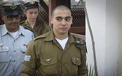 IDF Sgt. Elor Azaria arrives for a  court hearing at the Kirya military base in Tel Aviv, on January 24, 2017. (Flash90)