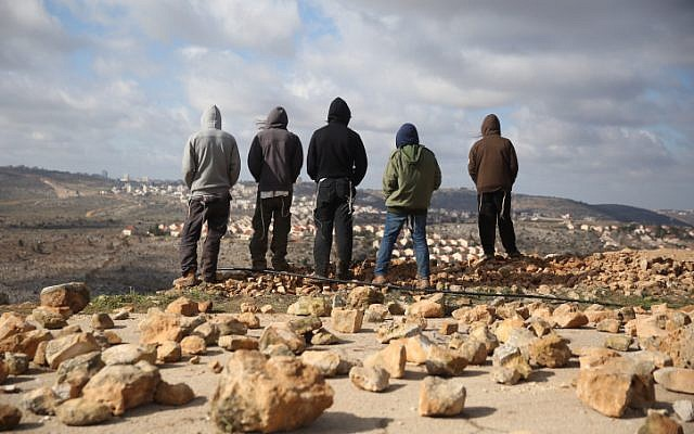 People gather in Amona ahead of the evacuation of the illegal outpost on February 1, 2017.  (Hadas Parush/Flash90)