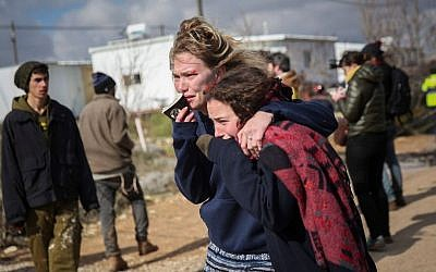 Israeli girls react during the evacuation of the illegal outpost of Amona, on February 1, 2017. (Hadas Parush/Flash90)