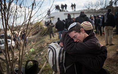 Two Jewish boys cry during the evacuation of the illegal Amona outpost in the West Bank on February 1, 2017. (Hadas Parush/Flash90)