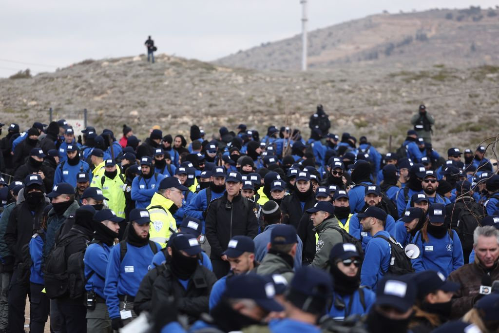 Israeli security forces gather ahead of the evacuation of the illegal outpost of Amona, on February 1, 2017. (Miriam Alster/Flash90)