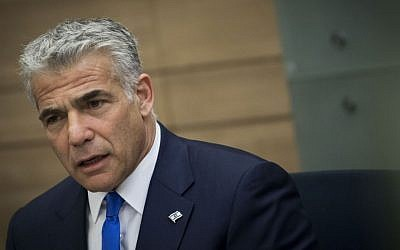 Yesh Atid chairman Yair Lapid leads a faction meeting at the Knesset on February 6, 2017. (Yonatan Sindel/Flash90)
