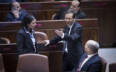 Jewish Home party leader and Education Minister Naftali Bennett, right, party colleague and Justice Minister Ayelet Shaked, left, and opposition leader MK Isaac Herzog (Zionist Union) in the Knesset just prior to the passage of the Regulation Law that retroactively legalizes West Bank settlement homes built on private Palestinian property. (Yonatan Sindel/Flash90)