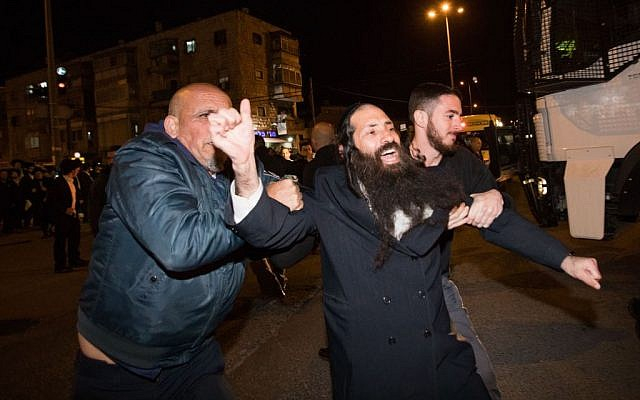 Ultra-Orthodox demonstrators during a protest against the jailing of Jewish seminary student who failed to comply with an army recruitment order, in Jerusalem's Mea Shearim neighborhood, February 7, 2017. (Yonatan Sindel/Flash90)