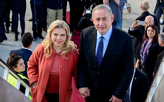 Prime Minister Benjamin Netanyahu and his wife Sara depart to the United States to meet with President Donald Trump, on February 13, 2017. (Avi Ohayon/GPO)