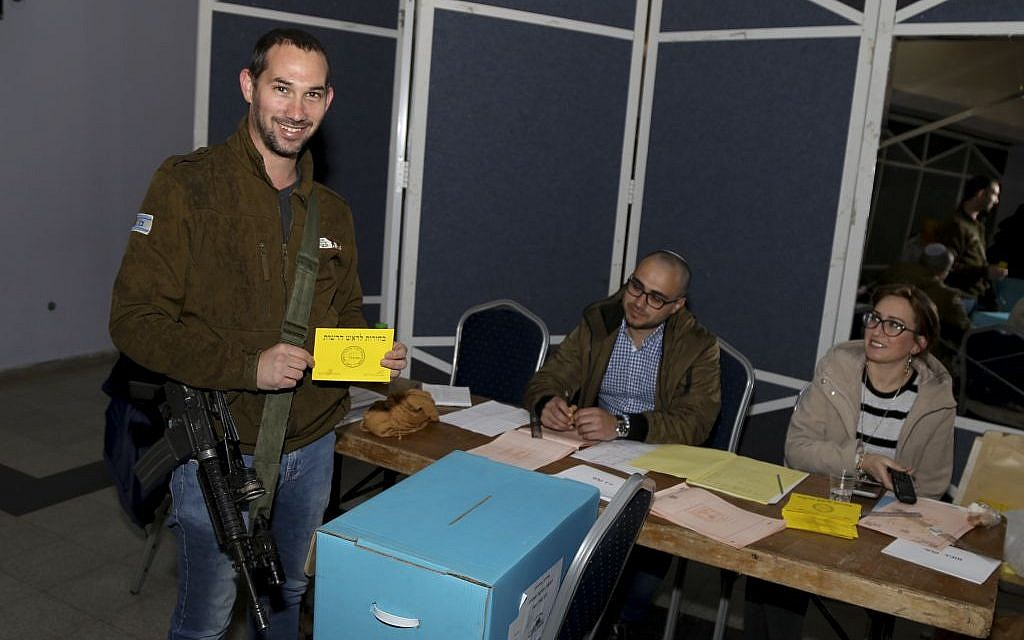 A local resident casts his vote in the elections for the mayor of Gush Etzion Regional Council, at a polling station in the settlement of Alon Shvut on February 14, 2017. (Photo by Gershon Elinson/Flash90)