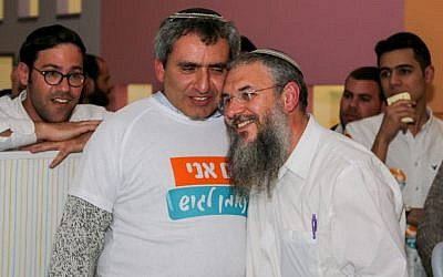 Jerusalem Affairs Minister Ze'ev Elkin seen with newly elected Gush Eztion Council head Shlomo Ne'eman at Ne'eman's election headquarters in Alon Shvut, Gush Etzion, February 14, 2017. (Gershon Elinson/Flash90)