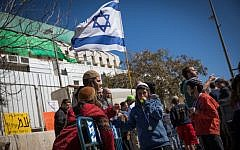 Evicted residents from the Israeli settlement of Amona protest in front of the Prime Minister Office in Jerusalem on February 19, 2017. (Yonatan Sindel/Flash90)