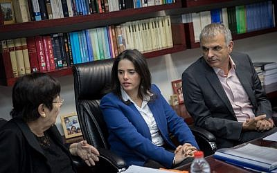 Miriam Naor, left, Ayelet Shaked, center, and Moshe Kahlon discussing Supreme Court candidates on February 22, 2017. (Yonatan Sindel/Flash 90)