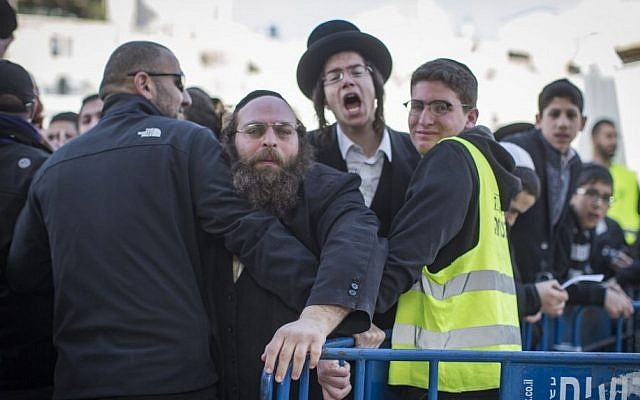 Ultra Orthodox men protest against the Women of the Wall movement as they hold a monthly prayer service at the Western Wall in Jerusalem Old City, February 27, 2017. (Hadas Parush/Flash90)
