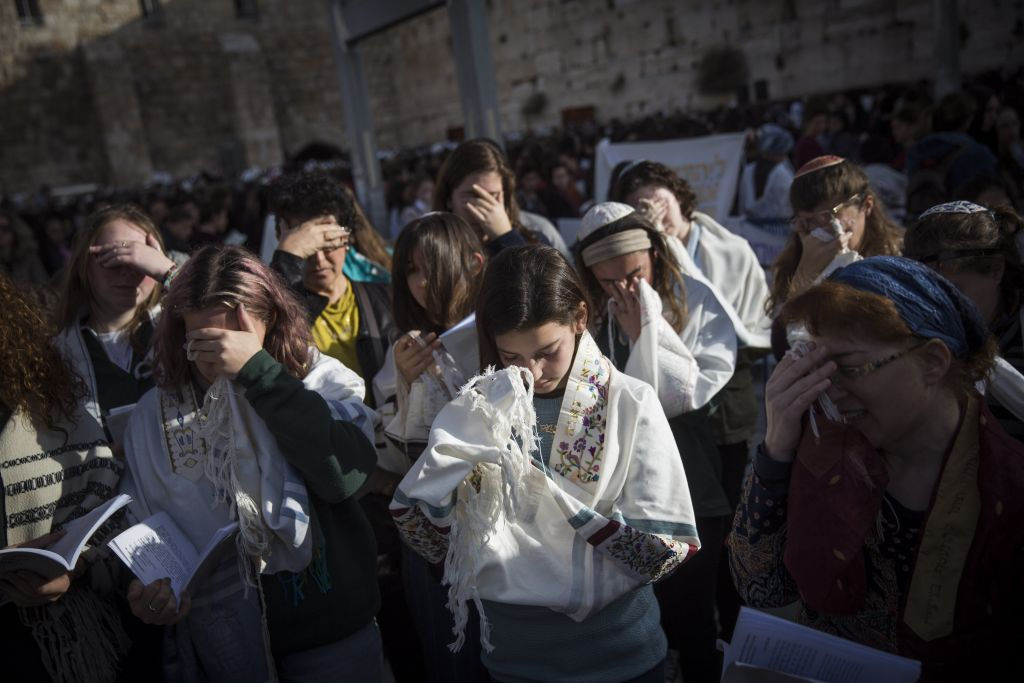Members of the Women of the Wall movement hold a monthly prayer service at the Western Wall in Jerusalem Old City, February 27, 2017. (Hadas Parush/Flash90)