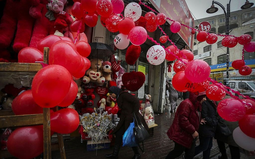 A Palestinian vendor sells gifts for Valentine's Day at a shop in the West Bank city of Ramallah on February 14, 2016. (Photo by Flash90)